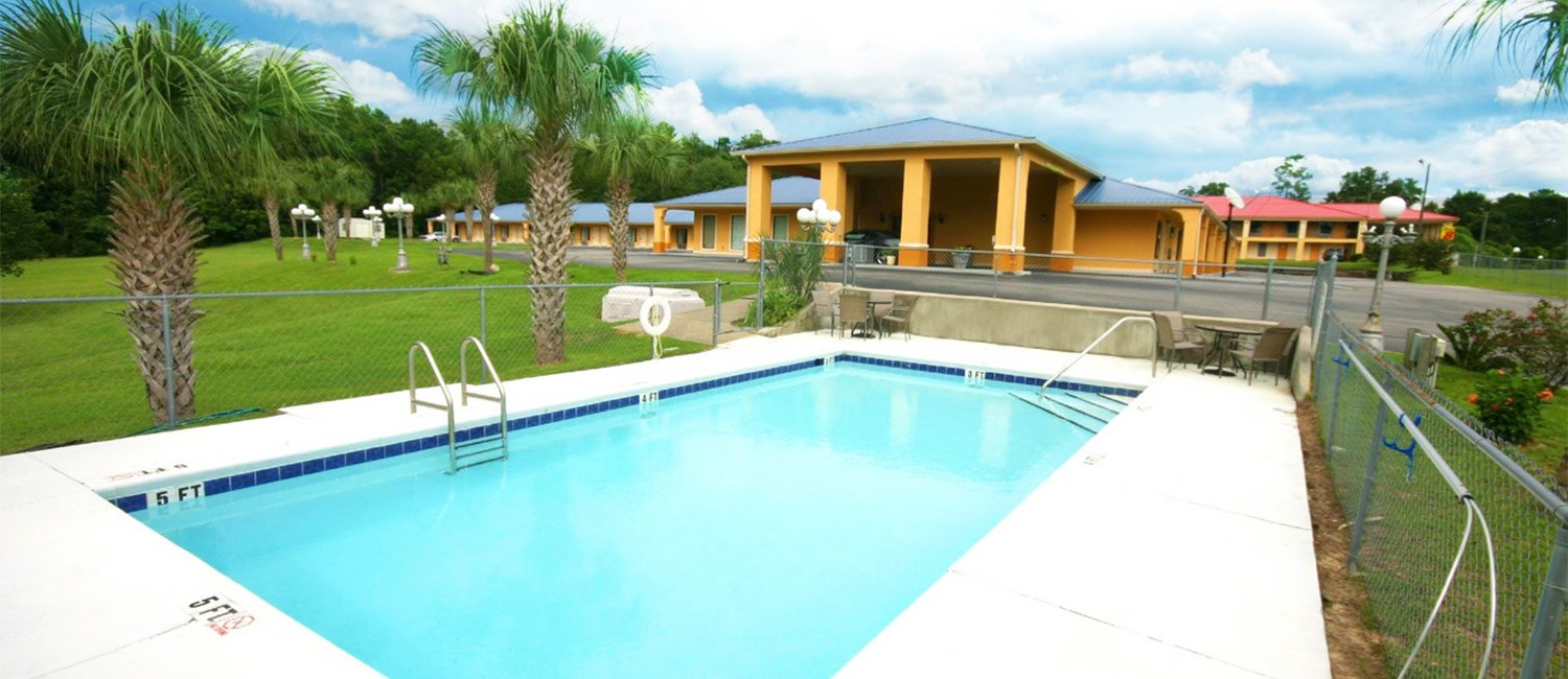 Soak Up The Florida Sun And Lounge By Our Pool